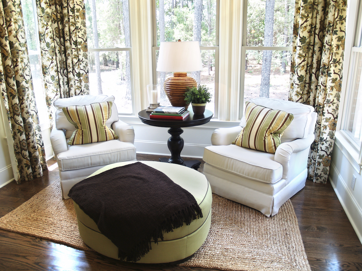 Two comfortable overstuffed chairs in a nicely decorated luxury sun-room