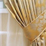 Closeup of gold panel and white curtain